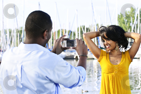 Woman posing for picture near boats stock photo, Beautiful woman posing for vacation photo at harbor by Elena Elisseeva