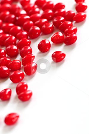 Valentine cinnamon heart candies stock photo, Red Valentine's cinnamon heart candies on white background by Elena Elisseeva