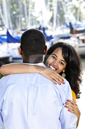 Happy woman hugging man stock photo, Beautiful young woman hugging boyfriend standing at harbor by Elena Elisseeva