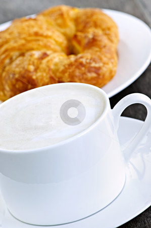 Latte coffee and croissant stock photo, Latte coffee with frothed milk and fresh croissant by Elena Elisseeva