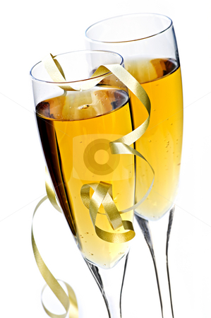 Champagne glasses stock photo, Two full champagne flutes with sparkling wine and ribbon isolated by Elena Elisseeva