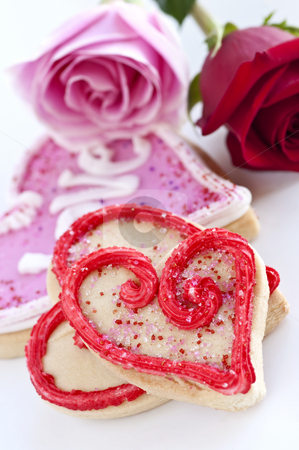 Valentines cookies and roses stock photo, Homemade baked shortbread Valentine cookies with roses by Elena Elisseeva