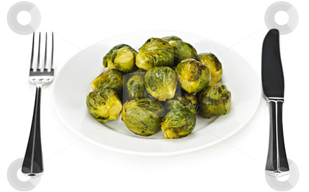 Plate of brussels sprouts stock photo, Plate of roasted green brussels sprouts with knife and fork isolated on white by Elena Elisseeva