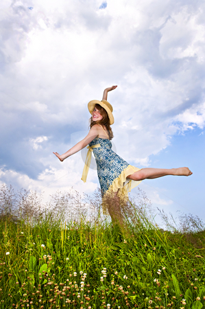 Young girl dancing in meadow stock photo, Young teenage girl dancing in summer meadow amid wildflowers by Elena Elisseeva