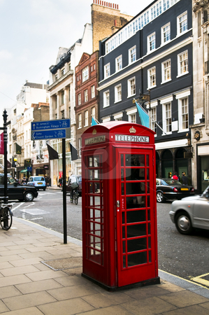 Telephone box in London stock photo, Red telephone box on busy London street in England by Elena Elisseeva