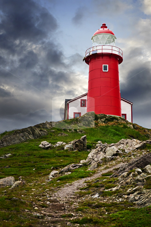 Lighthouse on hill stock photo, Red lighthouse on hill against stormy sky in Ferryland Newfoundland by Elena Elisseeva