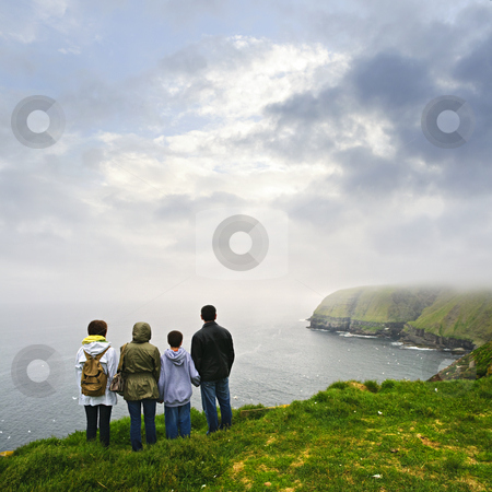 Family visiting Cape St. Mary's Ecological Bird Sanctuary in Newfoundland stock photo, Family looking from cliff at Cape St. Mary's Ecological Bird Sanctuary in Newfoundland, Canada by Elena Elisseeva