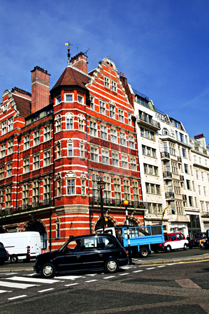 Busy street corner in London stock photo, London taxi on busy street corner in England by Elena Elisseeva