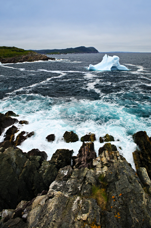 Melting iceberg stock photo, Melting iceberg off the coast of Newfoundland, Canada by Elena Elisseeva