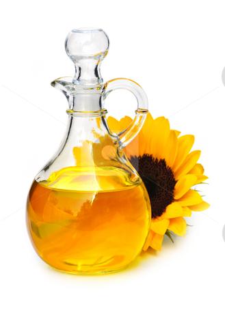 Sunflower oil bottle stock photo, Sunflower oil bottle and flower isolated on white by Elena Elisseeva