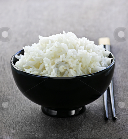 Rice bowl with chopsticks stock photo, White steamed rice in black round bowl with chopsticks by Elena Elisseeva