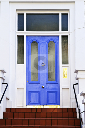 Blue door in London stock photo, Blue front door with brass knocker in London England by Elena Elisseeva