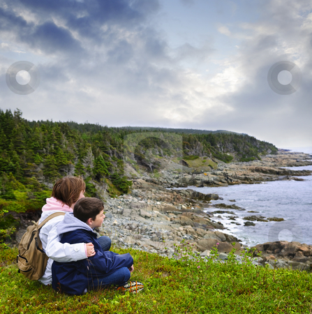 Children sitting at Atlantic coast in Newfoundland stock photo, Children looking at coastal view of rocky Atlantic shore in Newfoundland, Canada by Elena Elisseeva