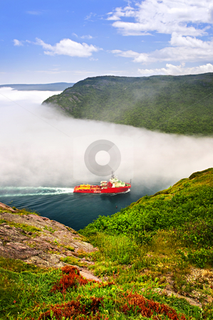 Ship entering the Narrows of St John's stock photo, Ship entering the Narrows of St John's harbor from Signal Hill in Newfoundland Canada by Elena Elisseeva