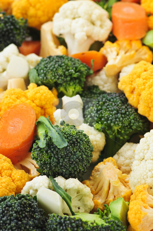 Broccoli cauliflower and carrots stock photo, Broccoli cauliflower and carrot vegetable pieces closeup by Elena Elisseeva
