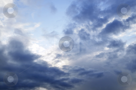 Stormy sky with sunshine stock photo, Stormy weather sky with sun shining through clouds by Elena Elisseeva