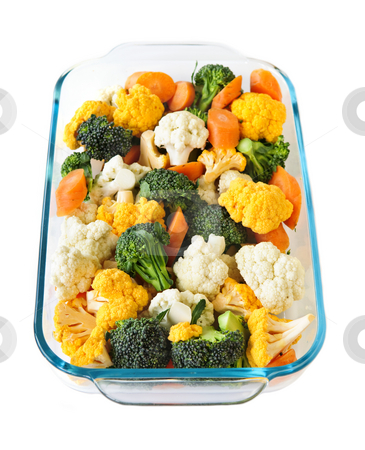Raw vegetables in baking dish stock photo, Raw cut vegetables in glass roasting pan by Elena Elisseeva