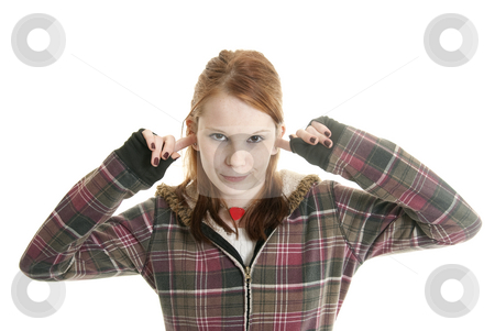 Teenage attitude stock photo, Annoyed teenage girl with her fingers in her ears by Christy Thompson