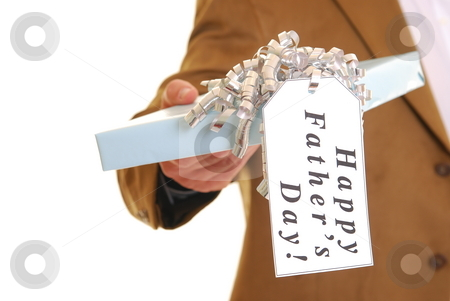Happy Father's Day stock photo, Man holding a present with a tag saying