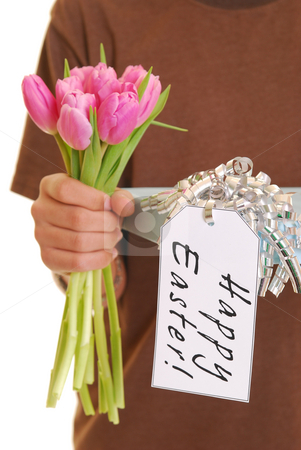 Teenager holding a present 2 stock photo, Teenager holding a present with tag saying