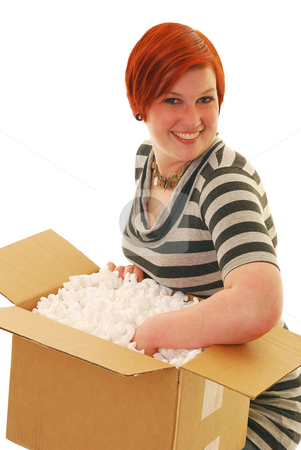 Happy delivery stock photo, An attractive young woman excited about a recent delivery. by Christy Thompson