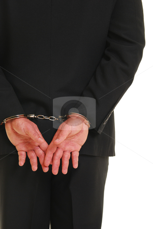 Handcuffed business man stock photo, Business man in handcuffs isolated on white by Christy Thompson