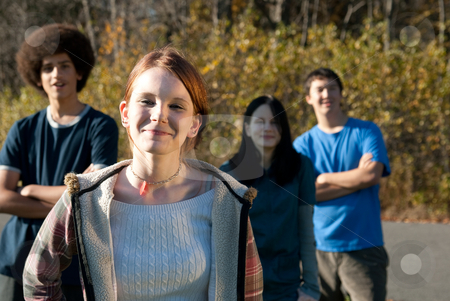 Ethnic teen friends stock photo, Teens of various ethnic backgrounds outdoors in the autumn by Christy Thompson