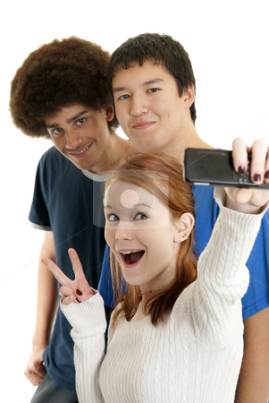 Ethnic teen friends stock photo, Three teens of different ethnic backgrounds smiling for the camera phone by Christy Thompson
