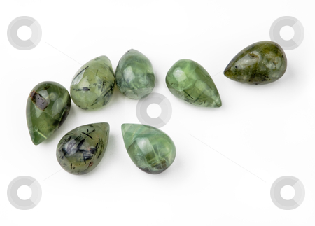 Green Garnet Tear Drops stock photo, Seven green garnet teardrop-shaped gemstones, isolated on white background by Eva Browning