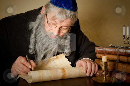 Jewish parchment stock photo, Old jewish man with beard writing on a parchment scroll by Anneke