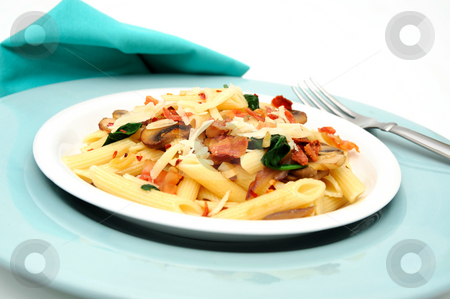 Penne Pasta Meal stock photo, Penne pasta with sauteed mushrooms garlic and Spinach with crumbled bacon and grated parmesan cheese severed on a turquoise and white plate combination. by Lynn Bendickson