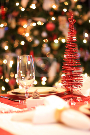 Christmas table stock photo, Set christmas dinner table, decorated christmas tree in background, selective focus by Johann Helgason