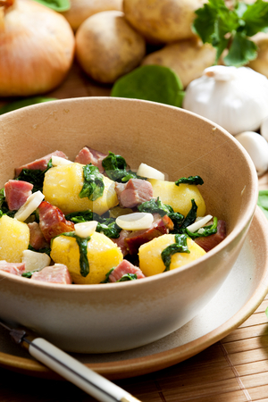 Potatoes with smoked meat stock photo, Potatoes with smoked meat, spinach and garlic by Richard Semik