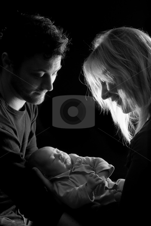 Lovely baby loving couple stock photo, Loving couple holding their newborn little baby by Anneke