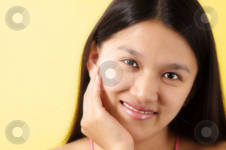 Pretty woman stock photo, A portrait of a smiling pretty woman with yellow background by Suprijono Suharjoto