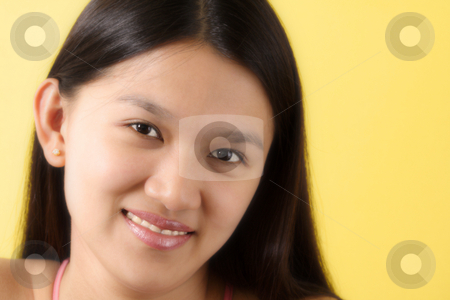 Pretty woman stock photo, A portrait of a smiling woman with yellow background by Suprijono Suharjoto
