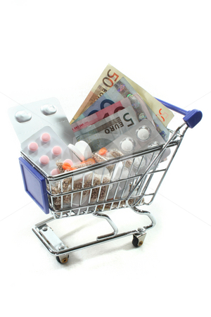 Shopping Cart with pills and money stock photo, Shopping Cart with tablets and euro notes by Marén Wischnewski