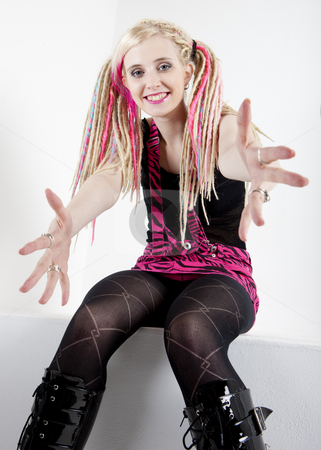 Sitting young woman with dreadlocks stock photo, Sitting young woman with dreadlocks by Richard Semik
