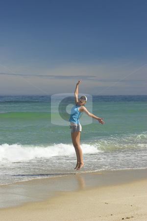 Summer jump stock photo, Beautiful woman jumping on a great day of summer on the beach by ikostudio
