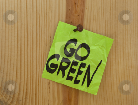 Go green concept stock photo, Go green reminder - green crumpled sticky note nailed to a wood plank or wall by Marek Uliasz