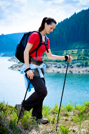 Hiking woman stock photo, Hiking woman in front of wilde nature by Val Thoermer