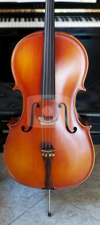 Cello panoramic view stock photo, Panoramic view of a cello standing out in front of a piano by Laurent Dambies