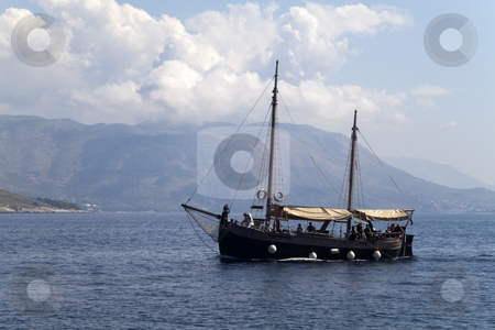 Small Ship stock photo, A old small ship out on the blue seas by Kevin Tietz