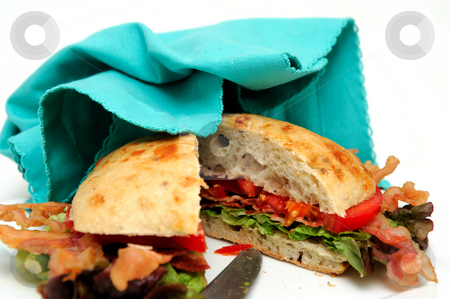Bacon Lettuce And Tomato Sandwich And Napkin stock photo, Bacon lettuce and tomato sandwich also known as a BLT on a Ciabatta roll served on a plate by Lynn Bendickson