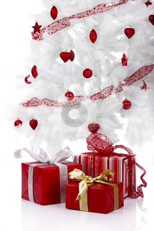 Christmas gifts stock photo, Christmas white tree and gifts over a white background by ikostudio