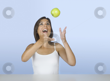 Apple diet stock photo, Beautiful young woman playing with an apple by ikostudio