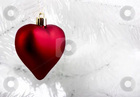Christmas ornaments stock photo, Christmas ornaments hanging from a white tree by ikostudio