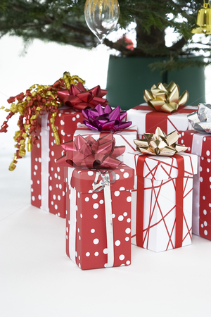 Christmas presents under the tree stock photo, Red and white christmas present under the tree by Yann Poirier