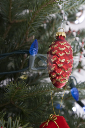 Christmas bulb stock photo, Red christmas bulb in the shape of a pine cone hanging from the tree by Yann Poirier