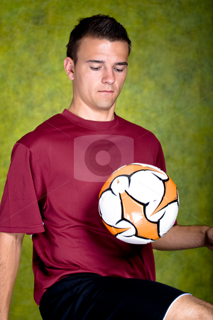 Soccer player stock photo, Soccer or football  player on the field by Val Thoermer